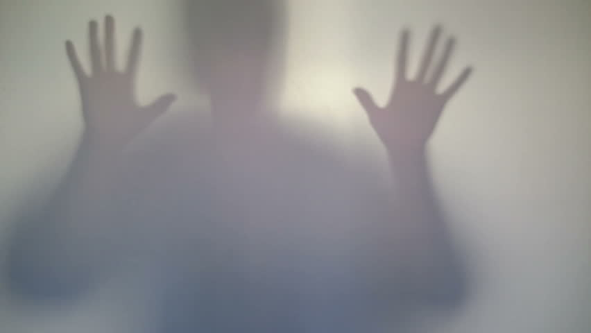 Terrifying male silhouette emerging, flashing, scary gestures