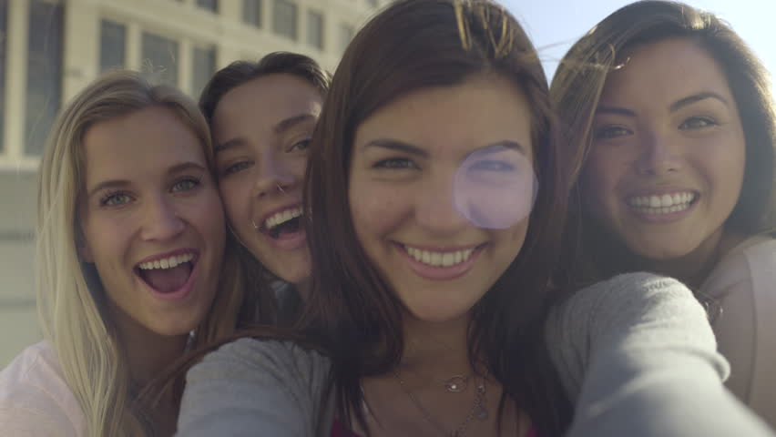 Closeup Of Carefree Teen Girls Making Funny Faces And Smiling For Selfies (4K) | Shutterstock HD Video #10819841