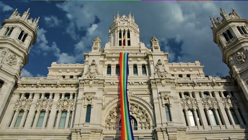 Rainbow flag in Madrid city hall with blue sky and clouds | Shutterstock HD Video #10891472
