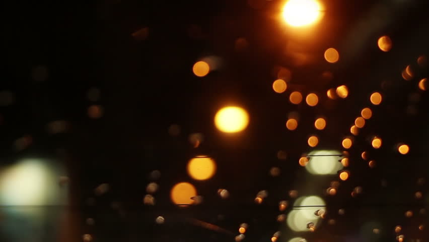 Blurry lights on road through rear window of car loopable