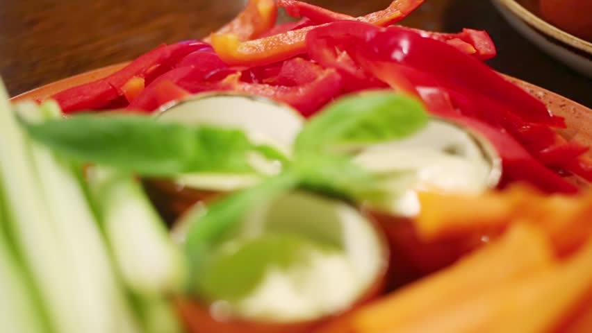 Cut into julienne vegetables and sauce on a plate in a restaurant - HD stock footage clip