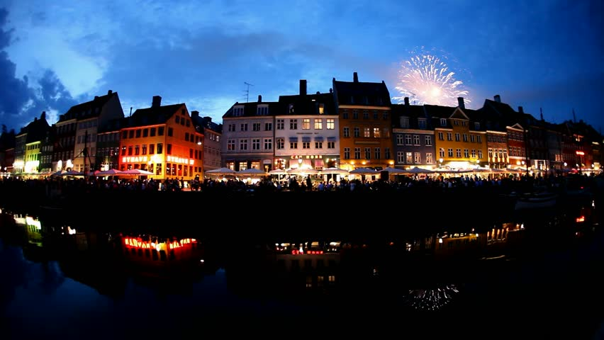 COPENHAGEN, DENMARK - JULY 5th, 2015: Scenic fireworks at night over old town Nyhavn,  a 17th century waterfront pier harbor, nightlife, colored houses, boats, canal and entertainment district  | Shutterstock HD Video #10931738