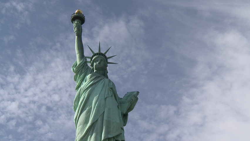 Statue of Liberty time-lapse with moving cloud and blue sky | Shutterstock HD Video #10947497
