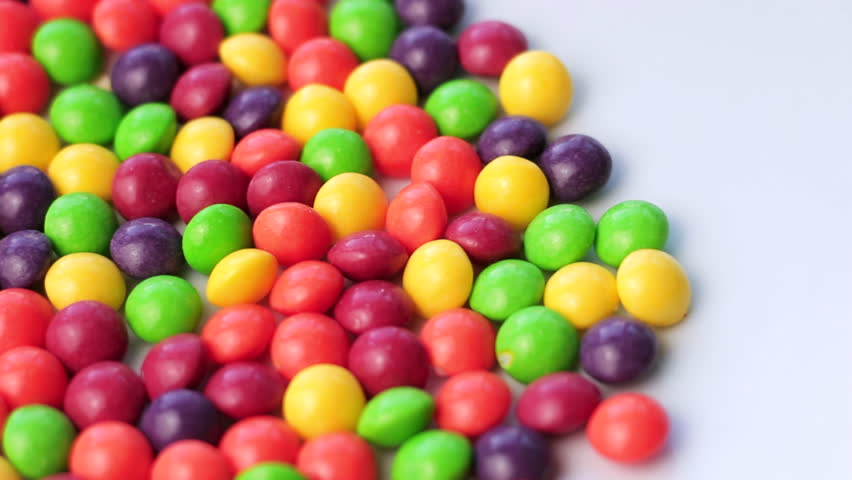 Pan Over Round Candy Sweets on White Background