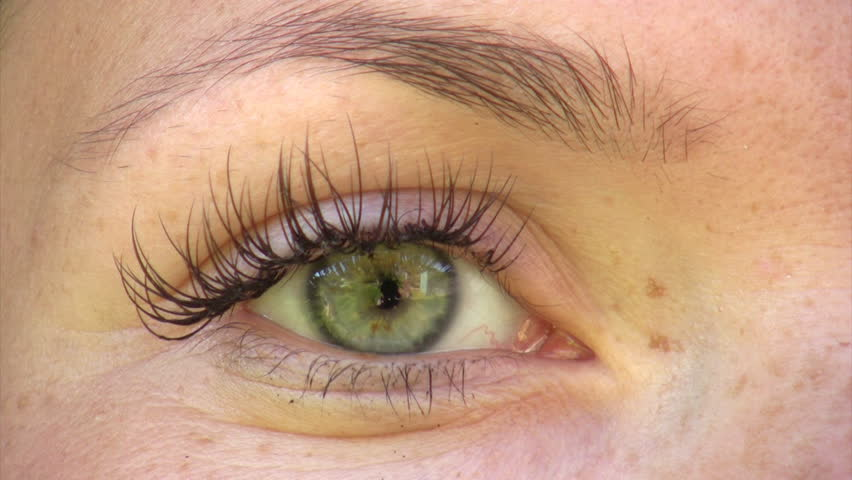 Close-up of young woman's green eye  - HD stock footage clip