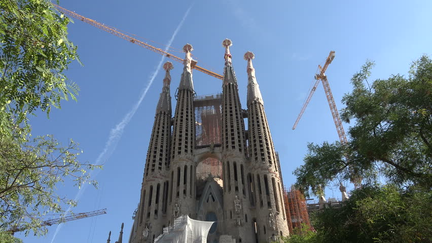 BARCELONA, SPAIN - SEPT 2014: Barcelona Spain Sagrada Familia tilt to crowd. Roman Catholic church and main tourist attraction and destination. Gothic modern cathedral.  Construction began in 1882.