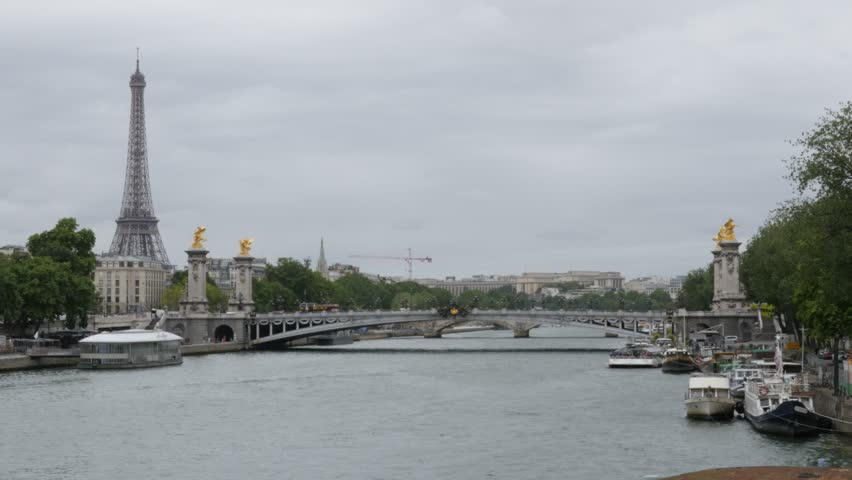 Well known Paris scenery with river Seine Eiffel tower and Alexandre III bridge 4K 2160p UltraHD tilt footage - Famous Paris sights by the day slow tilting 4K 3840X2160 UHD video - 4K stock video clip