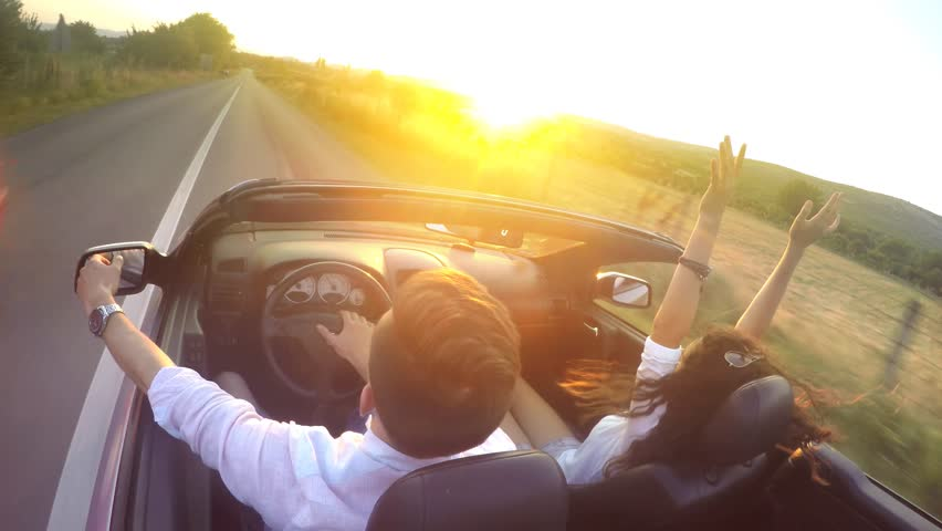 Couple driving convertible car cabriolet steadicam shot. UHD 4K stock footage | Shutterstock HD Video #11012360