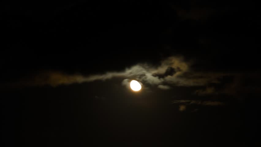 Night time lapse moon and clouds