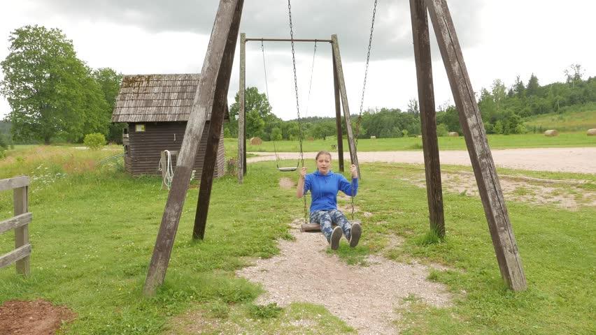 Girl on a seesaw | Shutterstock HD Video #11021585