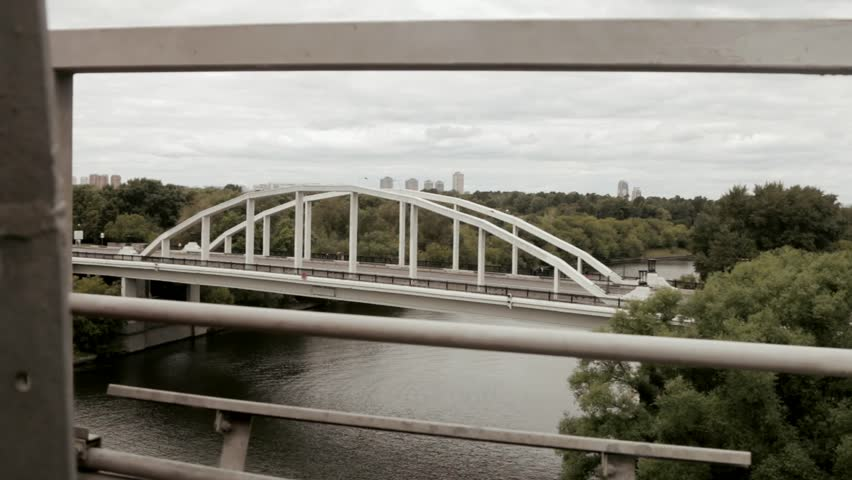 RUSSIA, MOSCOW - August 2, 2015: the stone bridge and road traffic that spans Moskva River. shot with slider - HD stock footage clip