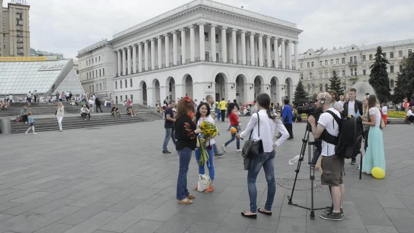 KYIV UKRAINE –  AUGUST, 24, 2014: Celebration Ukraine's Day of Independence. Ukraine tv channel Espreso.TV interviews two girls