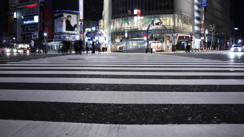 Time lapse footage with tilt up motion of famous crosswalk at dawn in Shibuya, Tokyo, Japan