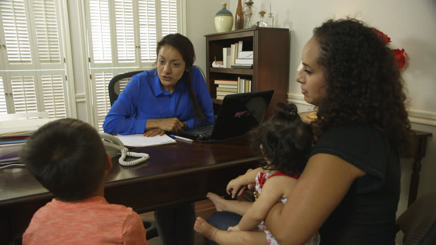 Cheerful CEO or small business owner greeting a client and her children during a meeting. . - HD stock video clip