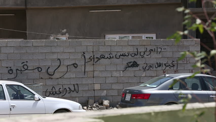 "AMERLI, IRAQ - MAY 2015: Slogans written on the walls at Amerli: ""Amerli is ISIS' graveyard"".Amerli steadfastness to ISIS was a turning point in the war between Iraqi government and ISIS"