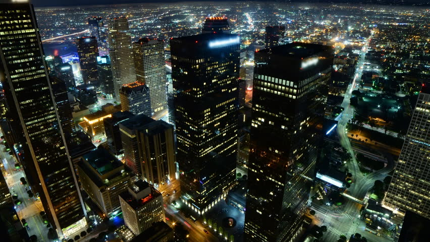 Time lapse footage with zoom out motion of downtown Los Angeles at night during Earth Hour, the global energy conservation event in 2015