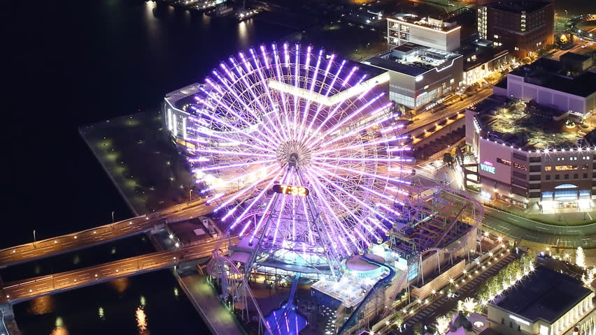 Time lapse footage of waterfront cityscape shot from Yokohama Landmark Tower at night in Japan -close up 2-