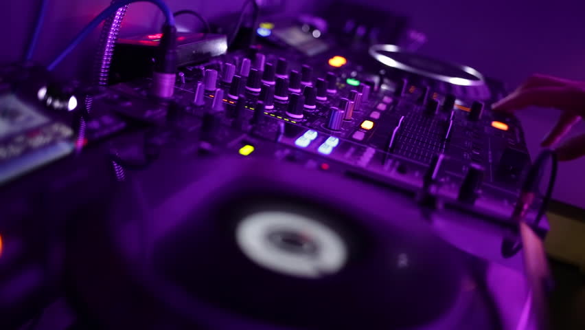 Dj playing and mixing music in a night club | Shutterstock HD Video #11104907