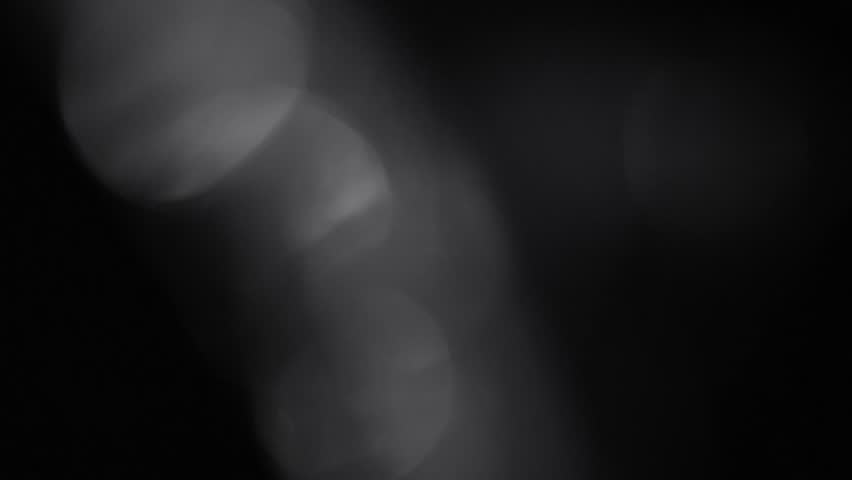 Fancy Light Effects In A Dark Background Stock Footage: Black And White Flowing Highlight Looping Animated