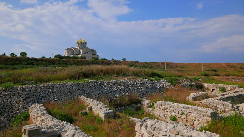 SEVASTOPOL, RUSSIA. JUNE 2015: Ancient walls of Chersonesos and the Cathedral of St. Vladimir. Shooting in 4K. The shutter speed is 1/50. With ND-filter and three-axis electronic stabilizer. | Shutterstock HD Video #11169338