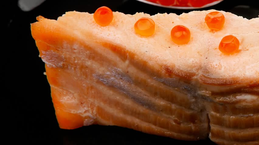 savory fish : norwegian salmon fillet roasted with green onion pen red caviar in spoon on black dish 1920x1080 intro motion slow hidef hd