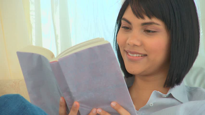 Asian woman reading a book in her bedroom - HD stock footage clip