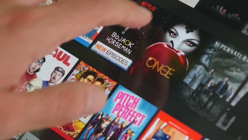 MONTREAL, CANADA - July 2015 : Netflix app. Selecting a movie video in the library to watch.