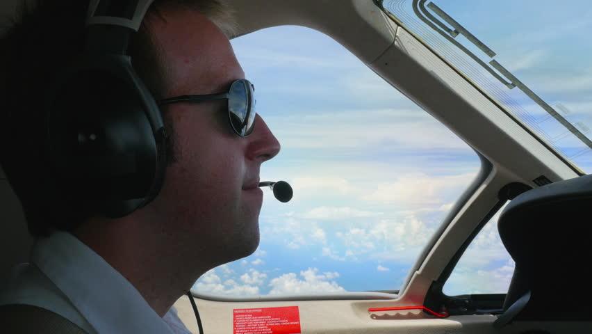 Jet Pilot in Cockpit Talking on Radio Headset during Flight - 4K stock footage clip