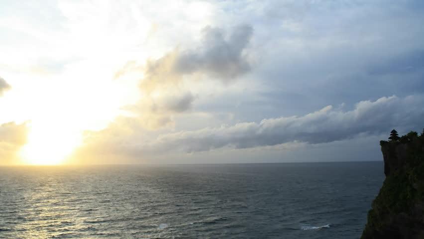 Time lapse sunset over Bali ocean at famous Sea Temple Uluwatu