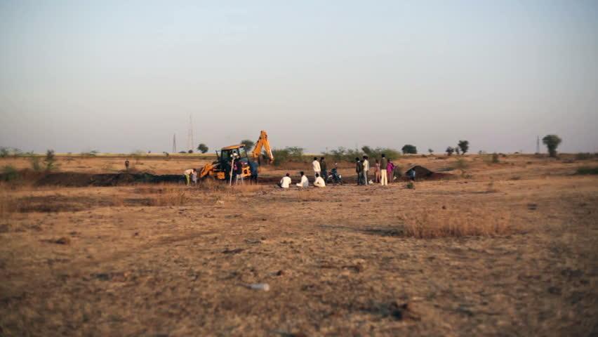 ANDHRA PRADESH, INDIA - CIRCA MAY 2013 - Bulldozer works in dry drought land, long shot - HD stock footage clip