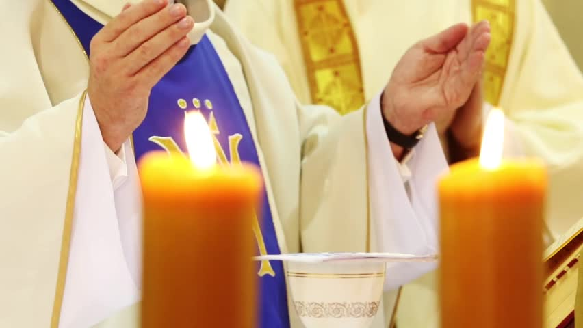 Priest celebrate mass at the church with follow focus shot - HD stock video clip