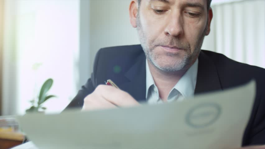 4k - Ultra HD - Businessman reads and signs a contract. smooth tracking shot (shot on ARRI, 4k Film scan) | Shutterstock HD Video #11283224