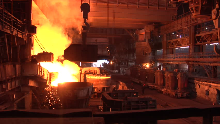 DONESK/UKRAINE - JAN 19 2012: Worker in White Helmet, helmet with cyrillic letters DMZ, Worker Comes Looking at the Furnace Crane is Transporting, workers are walking, steel vessels, metal becomes - HD stock video clip