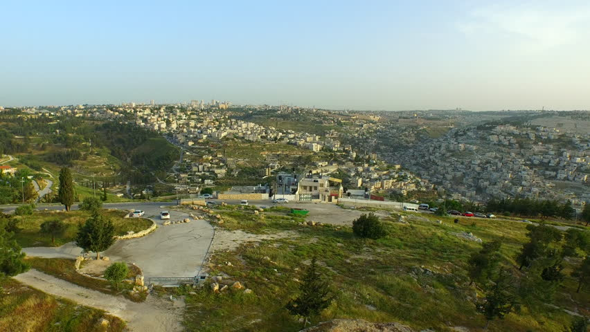 JERUSALEM REGION, ISRAEL - CIRCA MARCH 2015: Aerial of small towns in the hill country outside of Jerusalem, Israel.  | Shutterstock HD Video #11359049