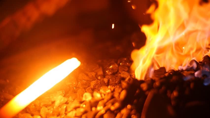 Slow Motion Blacksmith Forging a Sword