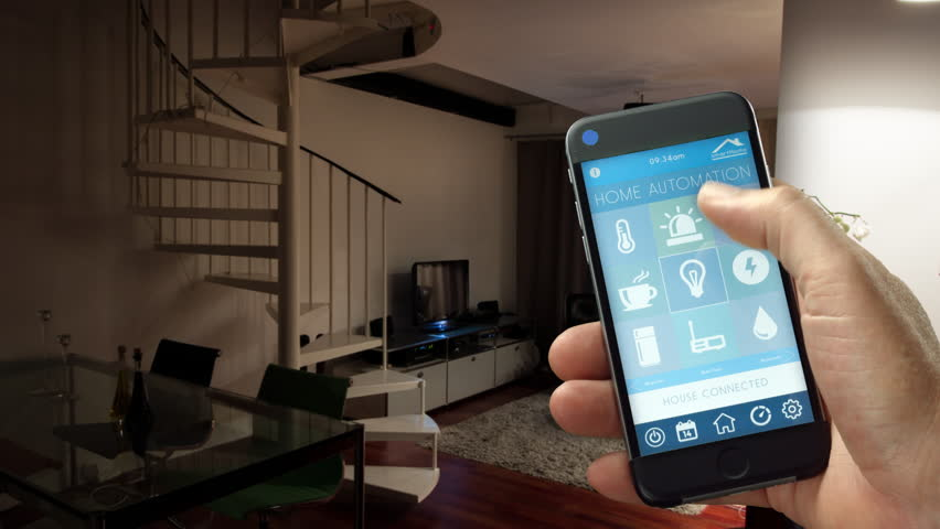 4k - Ultra HD - smart house, home automation, device with app icons. Man uses his smartphone with smarthome security app to turn on the lights o  his house. (Shot on RED)