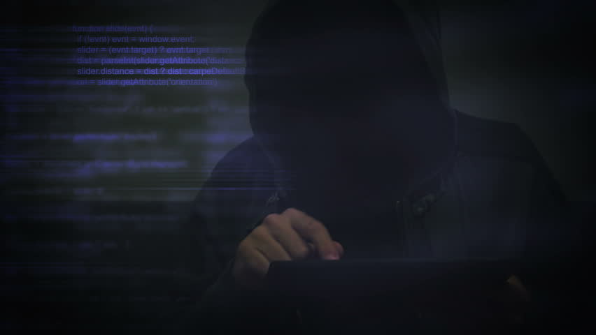 Unrecognizable hooded cyber criminal using digital tablet computer to access deep web internet page, p2p, piracy or network security concept, 1920x1080, 1080p full hd footage