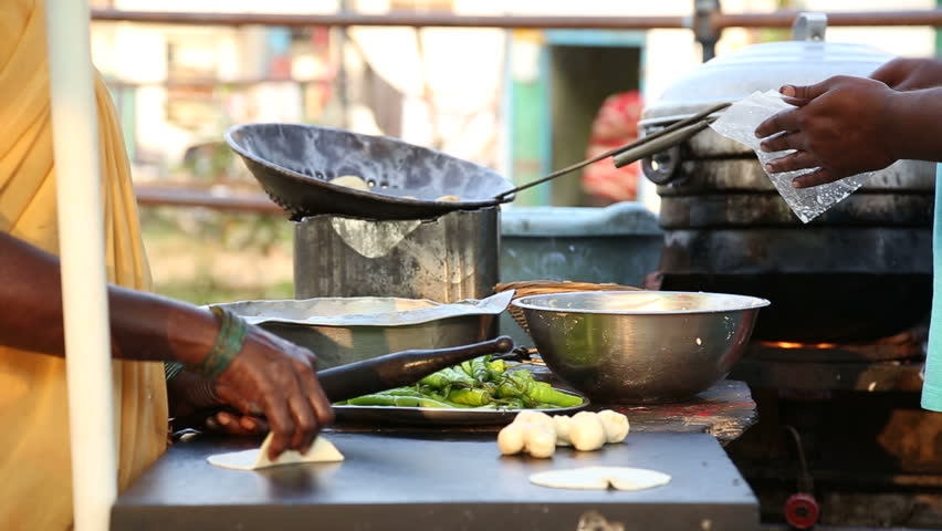Indian people preparing food on the street in Hampi.