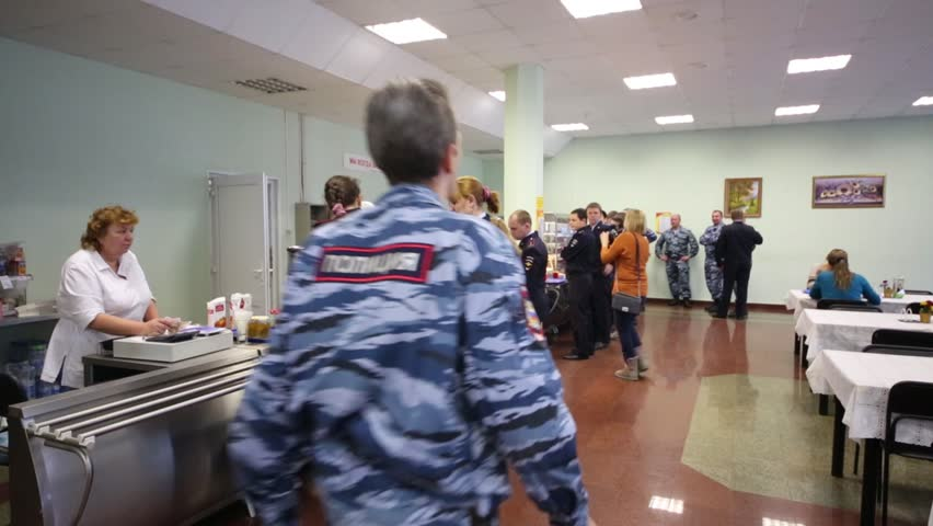 MOSCOW - NOV 14, 2014: People in canteen in police of Moscow North-East district. In 2014, Moscow police tracked down 1976 criminals - HD stock video clip