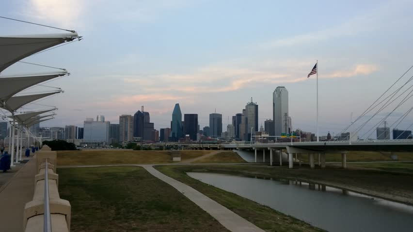 Dallas, Texas - August, 2015 - Static shot of the Dallas skyline at sunset from the Continental Avenue Pedestrian Bridge.