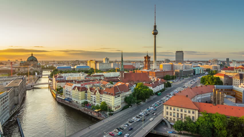 Timelapse view of the Berlin Skyline near Alexanderplatz. Transition From Day to Night. 4K Timelapse sequence.