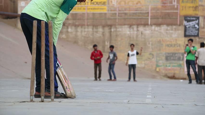 VARANASI, INDIA - 20 FEBRUARY 2015: Boys playing cricket on playground in Varanasi.