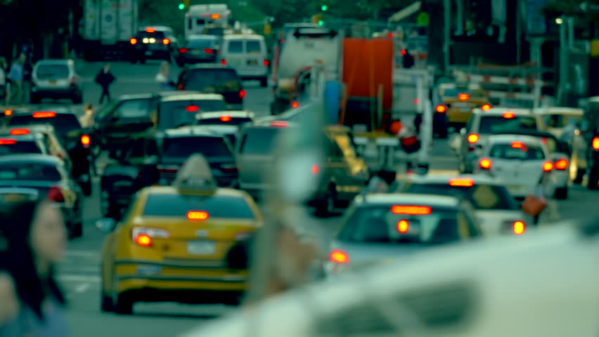 Busy street traffic, unrecognisable commuting cars and pedestrians on zebra crossing, June 2015, Lower Manhattan NYC