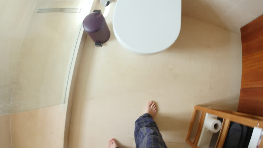 Point of view of man going to and using the toilet