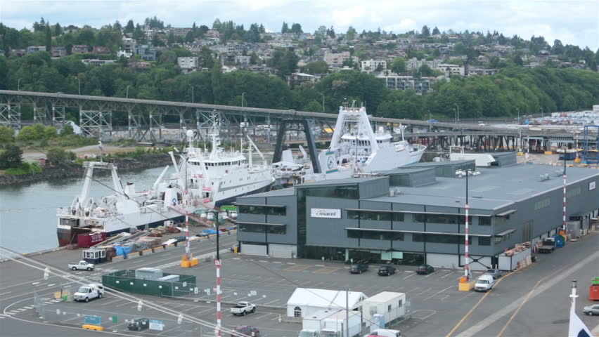 SEATTLE, WASHINGTON - MAY 2014: Seattle Pier 91 fishing and cruise ship dock port. Major tourism destination for departure, arrival of Alaska bound cruise ships. Tourist vacation on northwest coast. - HD stock video clip