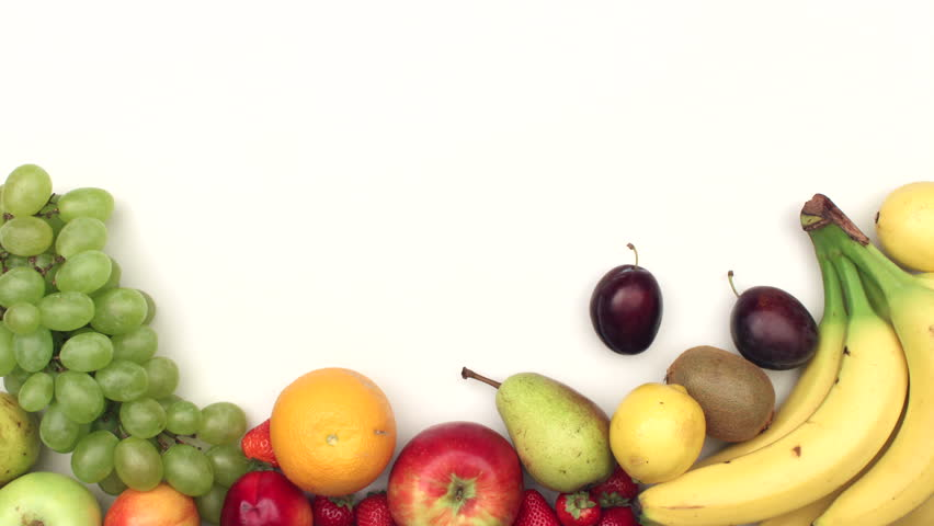 Fresh fruits moving on white background with copyspace - stop motion animation