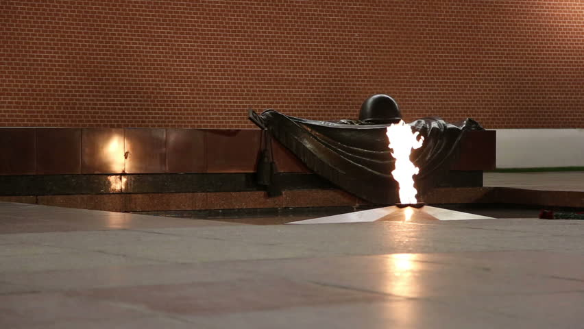 Eternal flame at the Tomb of the Unknown Soldier in the Alexander Garden to honor the dead of the Great Patriotic War, Kremlin wall. Moscow, Russia  - HD stock footage clip
