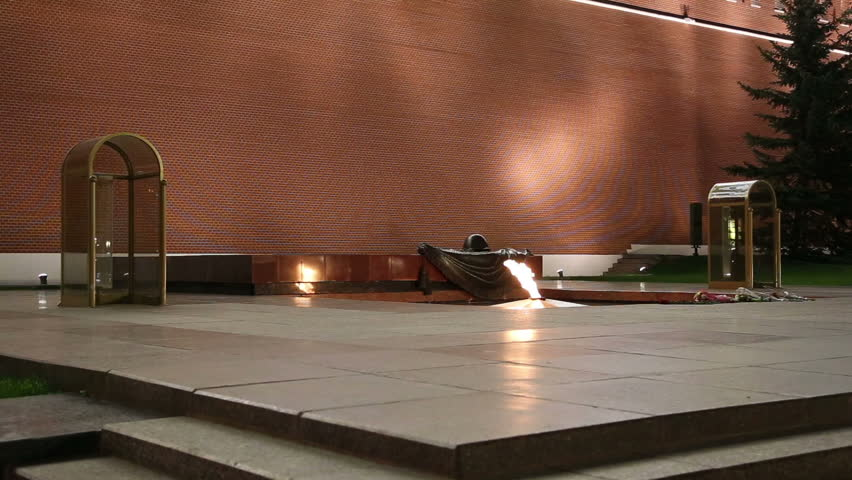 Eternal flame at the Tomb of the Unknown Soldier in the Alexander Garden to honor the dead of the Great Patriotic War, Kremlin wall. Moscow, Russia  - HD stock video clip