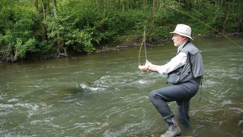 Man fishing trout in river