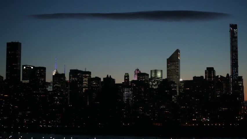 Midtown Manhattan skyline and dark cloud on the sky at sunset, New York City, USA. - HD stock footage clip